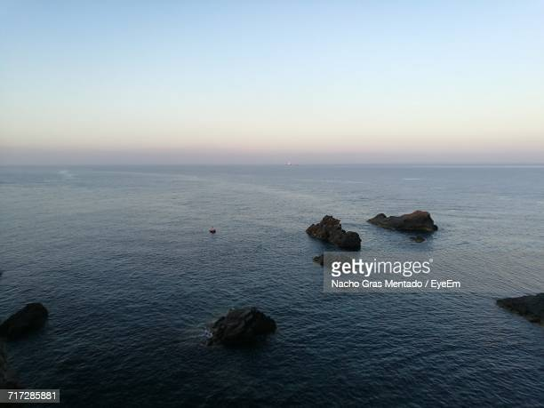 scenic view of sea against sky at sunset - gras stock pictures, royalty-free photos & images