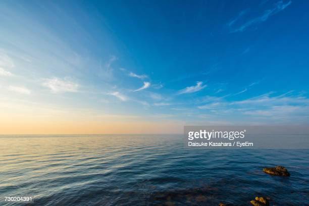 scenic view of sea against sky at sunset - horizon over water stock pictures, royalty-free photos & images