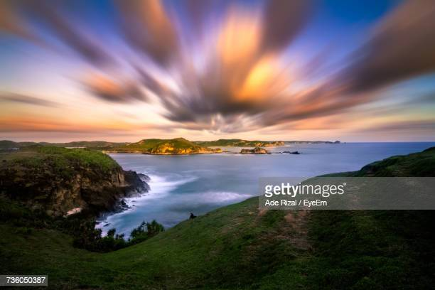 scenic view of sea against sky at sunset - ade rizal stock photos and pictures