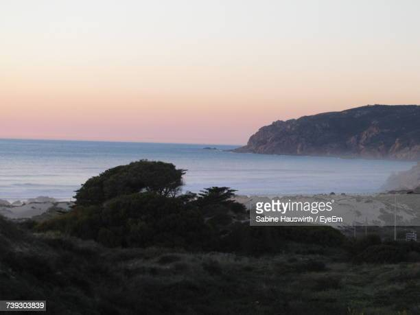 scenic view of sea against sky at sunset - sabine hauswirth stock pictures, royalty-free photos & images