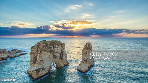 scenic view of sea against sky at sunset - libanon stock-fotos und bilder