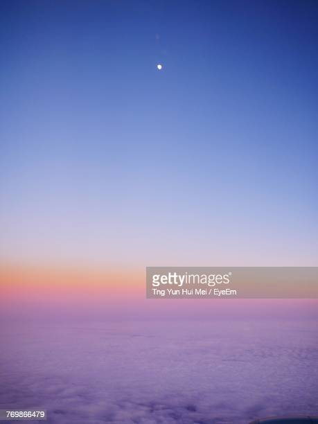 scenic view of sea against sky at sunset - pink moon stock pictures, royalty-free photos & images