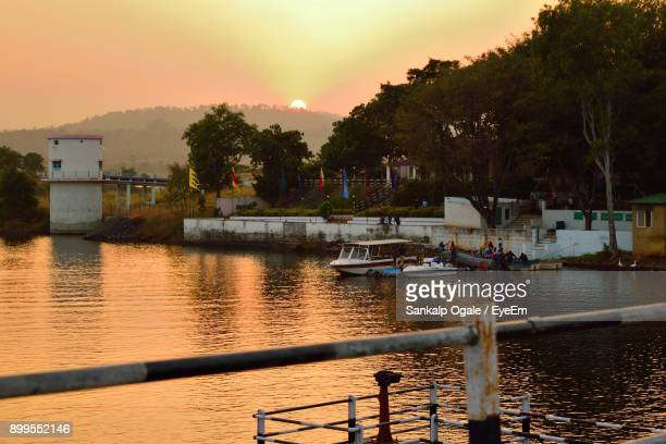 scenic view of sea against sky at sunset - indore stock photos and pictures