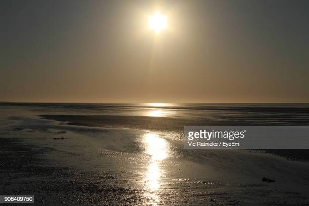 scenic view of sea against sky at sunset - ratnieks stock pictures, royalty-free photos & images