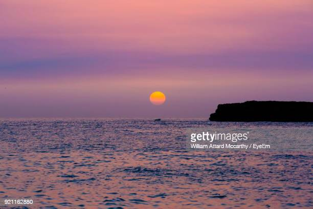 scenic view of sea against sky at sunset - william moon stock pictures, royalty-free photos & images
