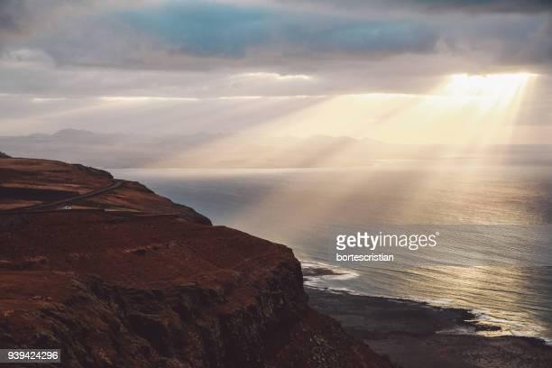 scenic view of sea against sky at sunset - bortes photos et images de collection