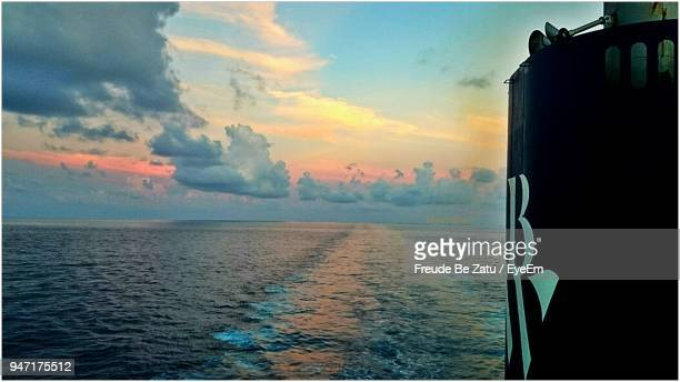 scenic view of sea against sky at sunset - freude stock pictures, royalty-free photos & images