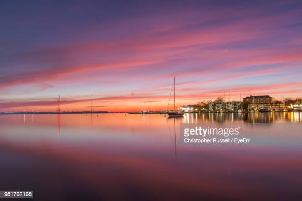 scenic view of sea against sky at sunset - annapolis stock pictures, royalty-free photos & images