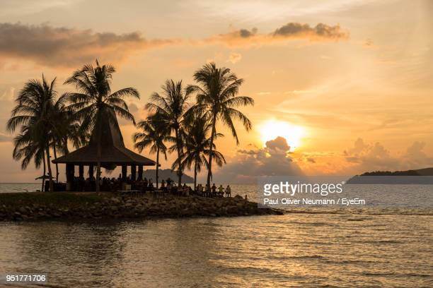 scenic view of sea against sky at sunset - kota kinabalu stock pictures, royalty-free photos & images
