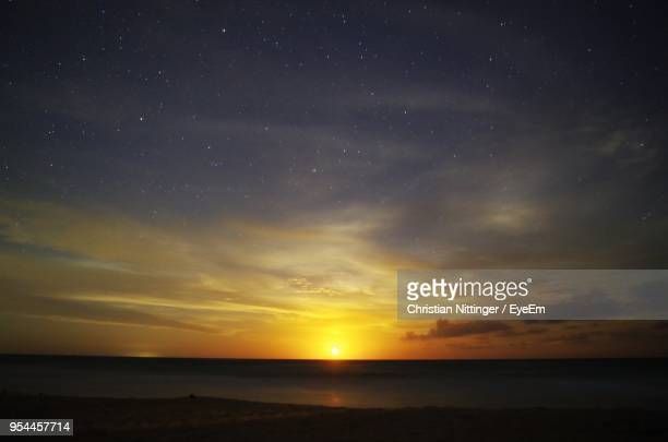scenic view of sea against sky at sunset - quintana roo stock photos and pictures