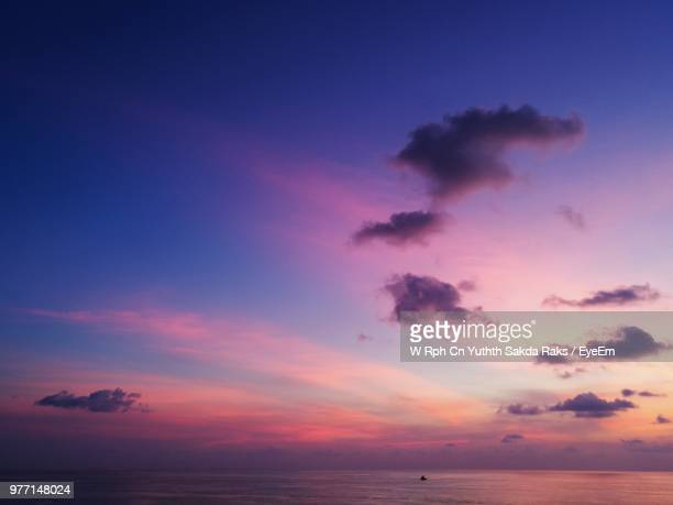 scenic view of sea against sky at sunset - colorful sunset stock photos and pictures