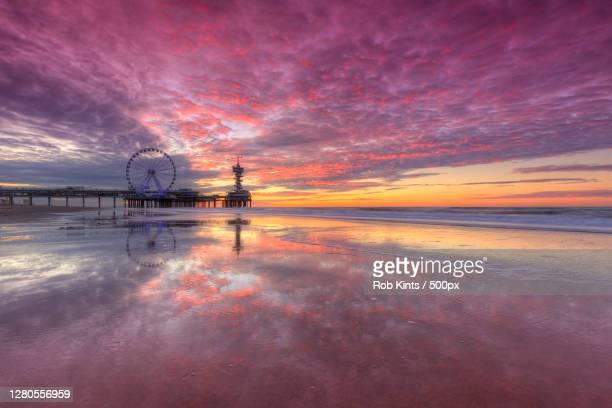 scenic view of sea against sky at sunset,scheveningen,den haag,netherlands - scheveningen stock pictures, royalty-free photos & images