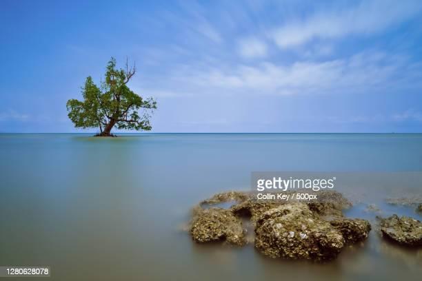 scenic view of sea against sky, bira bonto bahari bulukumba regency, south sulawesi, indonesia - collin key stock-fotos und bilder