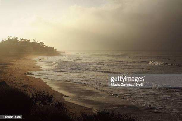 scenic view of sea against sky during foggy weather - malibu stock pictures, royalty-free photos & images
