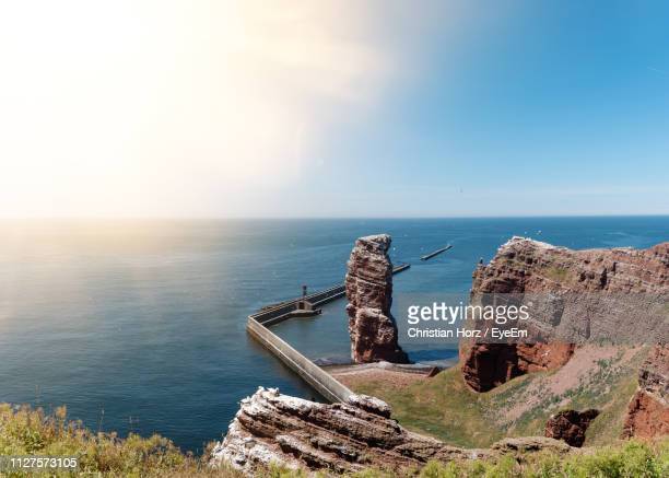 scenic view of sea against sky during sunny day - helgoland stock pictures, royalty-free photos & images