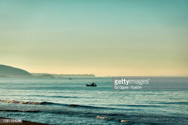 scenic view of sea against sky during sunrise - kanagawa prefecture stock pictures, royalty-free photos & images