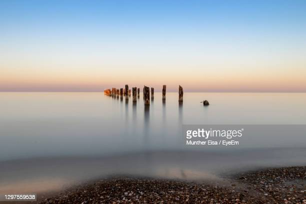 scenic view of sea against sky during sunrise - netanya stock pictures, royalty-free photos & images
