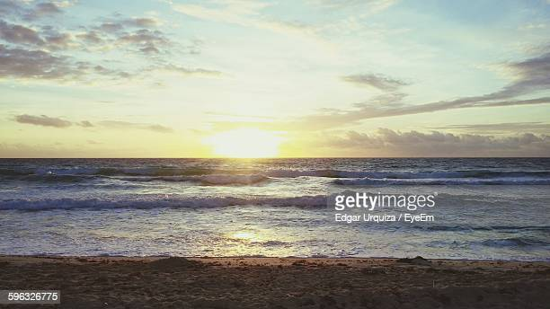 Scenic View Of Sea Against Sky During Sunrise