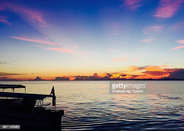 scenic view of sea against sky during sunset at mabul island - mabul island stock photos and pictures