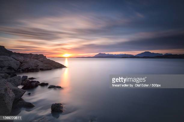 scenic view of sea against sky during sunset, isle of skye, united kingdom - sunset stock pictures, royalty-free photos & images