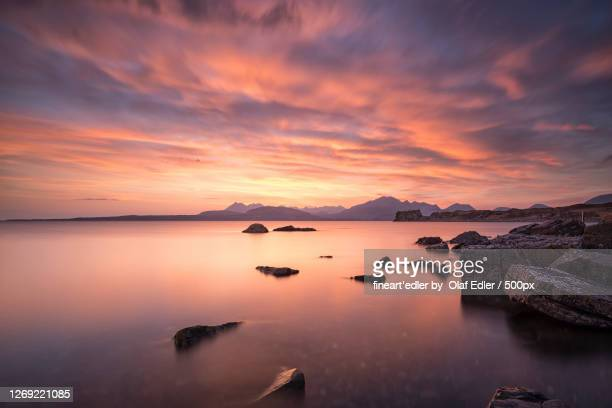 scenic view of sea against sky during sunset, isle of skye, united kingdom - mountain stock pictures, royalty-free photos & images