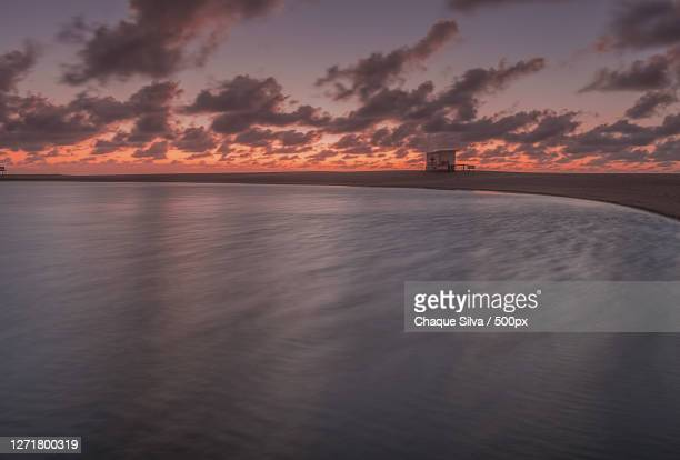 scenic view of sea against sky during sunset, miramar, argentina - chaque photos et images de collection
