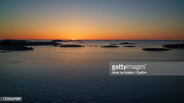 scenic view of sea against sky during sunset over a scandinavian coast - arne jw kolstø stock pictures, royalty-free photos & images