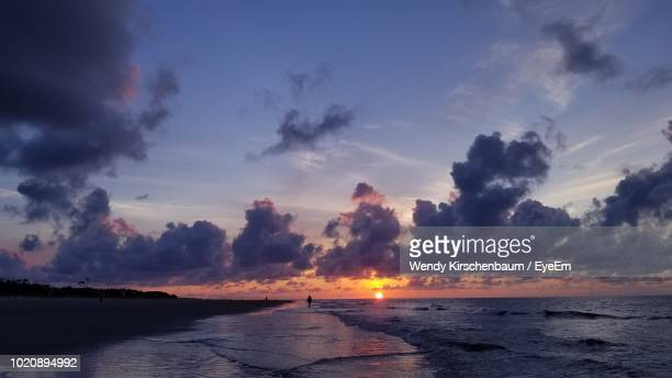 scenic view of sea against sky during sunset - hilton head stock pictures, royalty-free photos & images