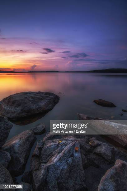 scenic view of sea against sky during sunset - jyväskylä stock photos and pictures