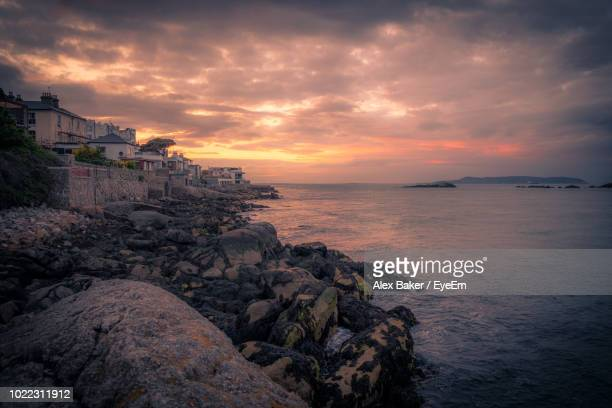 scenic view of sea against sky during sunset - dalkey stock pictures, royalty-free photos & images