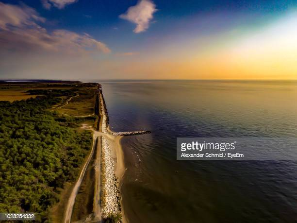 scenic view of sea against sky during sunset - ラヴェンナ ストックフォトと画像