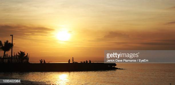 scenic view of sea against sky during sunset - davao city stock photos and pictures