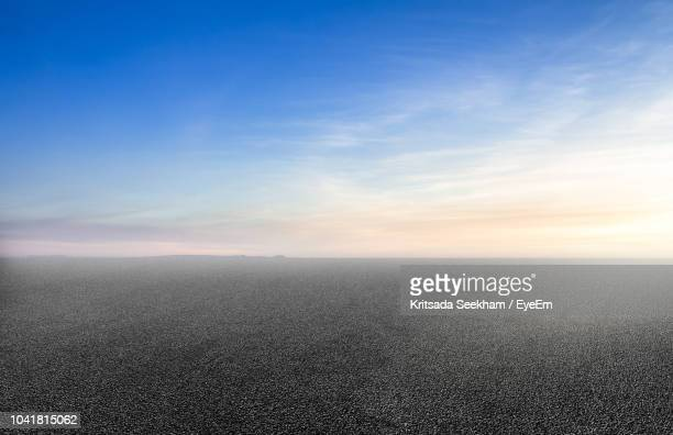 scenic view of sea against sky during sunset - horizon over land stock pictures, royalty-free photos & images