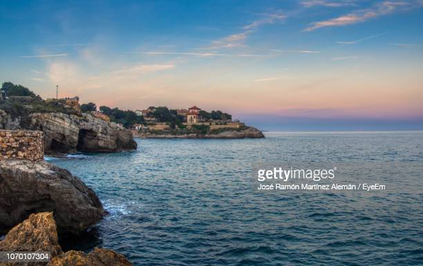 scenic view of sea against sky during sunset - tarragona stock photos and pictures