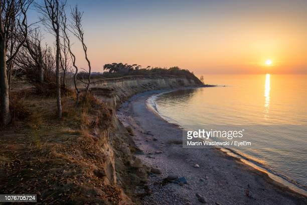 scenic view of sea against sky during sunset - mecklenburg vorpommern stock pictures, royalty-free photos & images