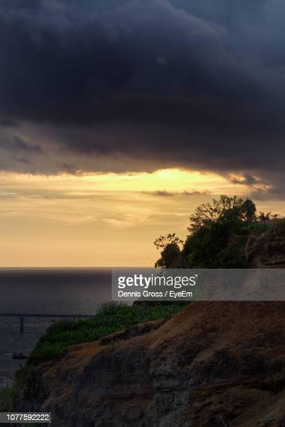 scenic view of sea against sky during sunset - storm dennis stock pictures, royalty-free photos & images
