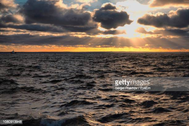 scenic view of sea against sky during sunset - sergei stock pictures, royalty-free photos & images