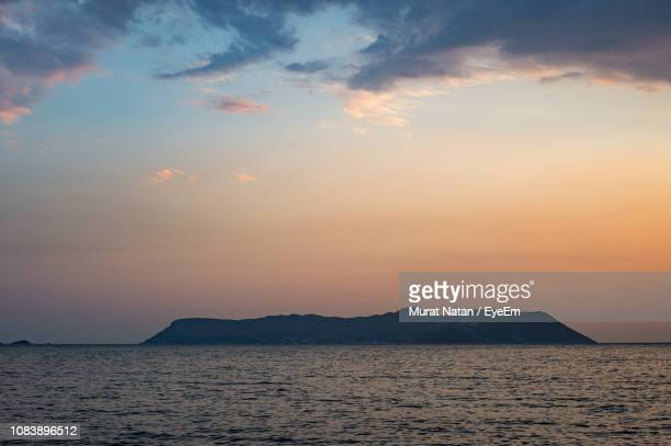 scenic view of sea against sky during sunset - mugla province stock pictures, royalty-free photos & images