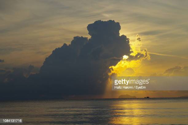 scenic view of sea against sky during sunset - hakimi stock photos and pictures
