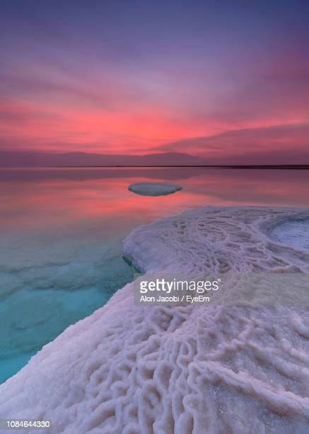 scenic view of sea against sky during sunset - dead sea stock pictures, royalty-free photos & images