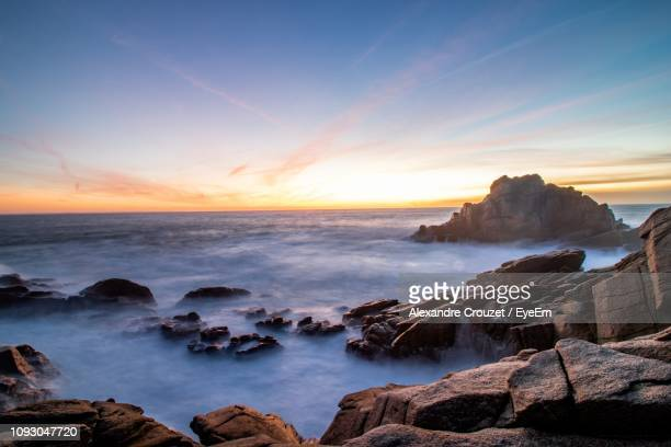 scenic view of sea against sky during sunset - alexandre coste foto e immagini stock