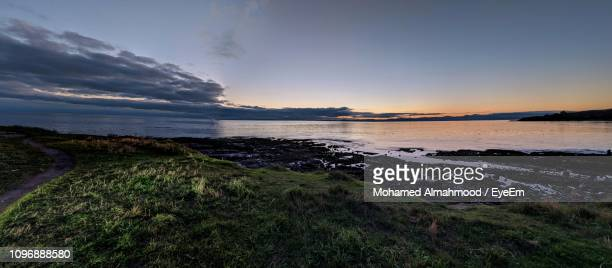scenic view of sea against sky during sunset - british columbia stock pictures, royalty-free photos & images