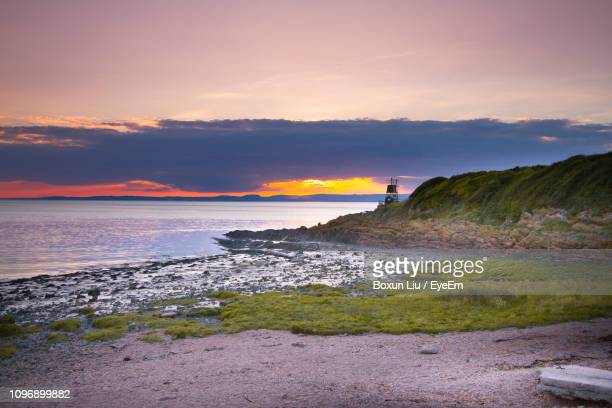 scenic view of sea against sky during sunset - liu he stock pictures, royalty-free photos & images