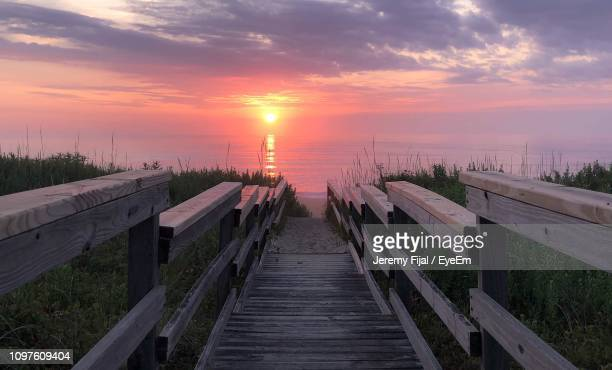 scenic view of sea against sky during sunset - kitty hawk stock pictures, royalty-free photos & images