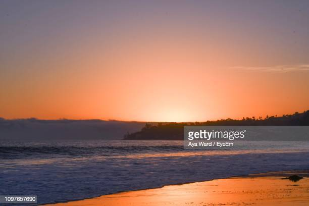scenic view of sea against sky during sunset - malibu stock pictures, royalty-free photos & images