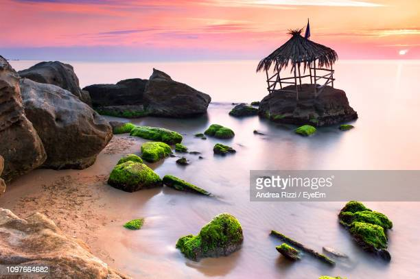 scenic view of sea against sky during sunset - andrea rizzi stockfoto's en -beelden