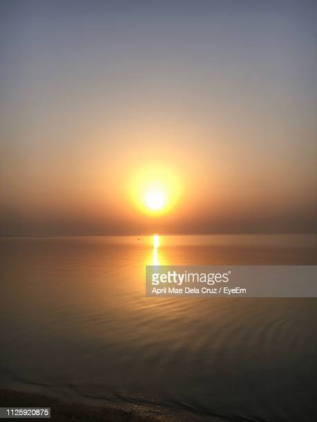 scenic view of sea against sky during sunset - qatar stock pictures, royalty-free photos & images