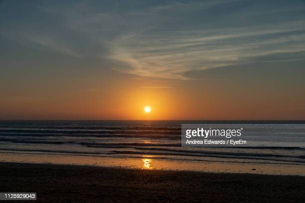 scenic view of sea against sky during sunset - agadir photos et images de collection
