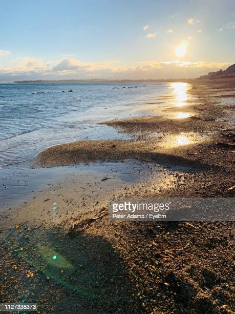 scenic view of sea against sky during sunset - peter adams stock pictures, royalty-free photos & images
