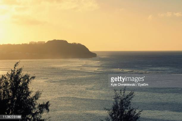 scenic view of sea against sky during sunset - guam stock pictures, royalty-free photos & images